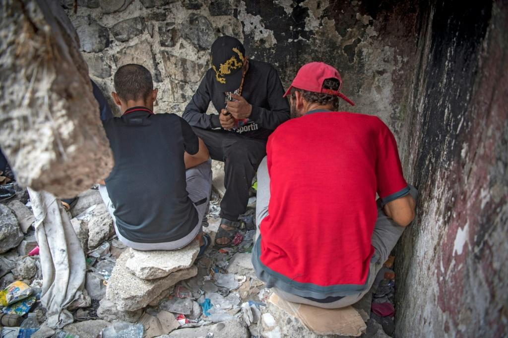 Moroccan addicts smoke heroin in a squat behind a police station in the Moroccan city of M'diq near Tetouan