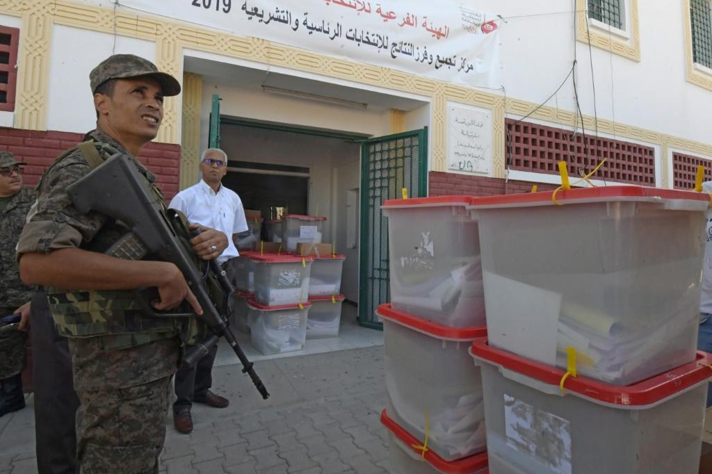 Tunisia's parliamentary election comes just before an October 13 two-way run-off in a presidential contest pitting a jailed business tycoon against a law professor