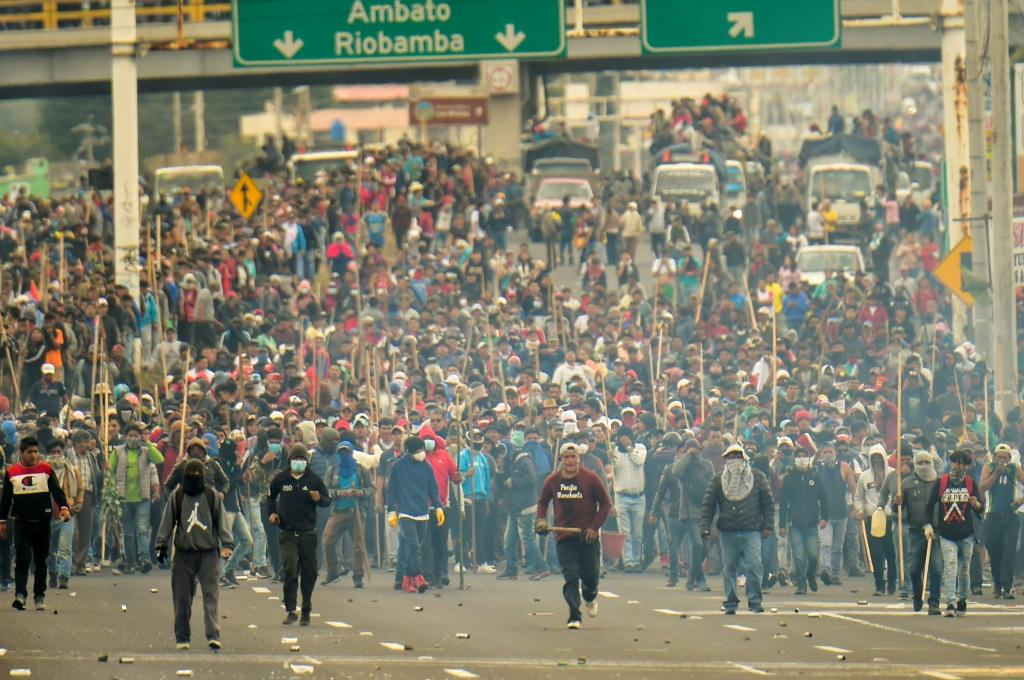 Indigenous people and farmers block a road in Machachi, on the outskirts of the capital Quito on October 7, 2019