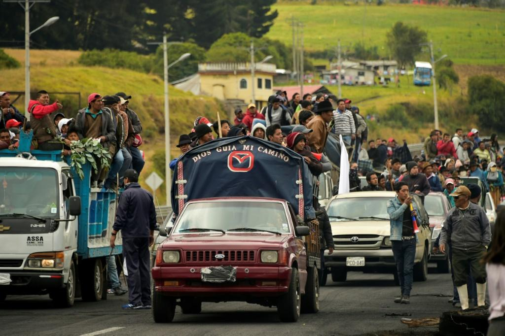 Indigenous people and farmers travel on trucks on their way to Quito in protest against the government's economic policies