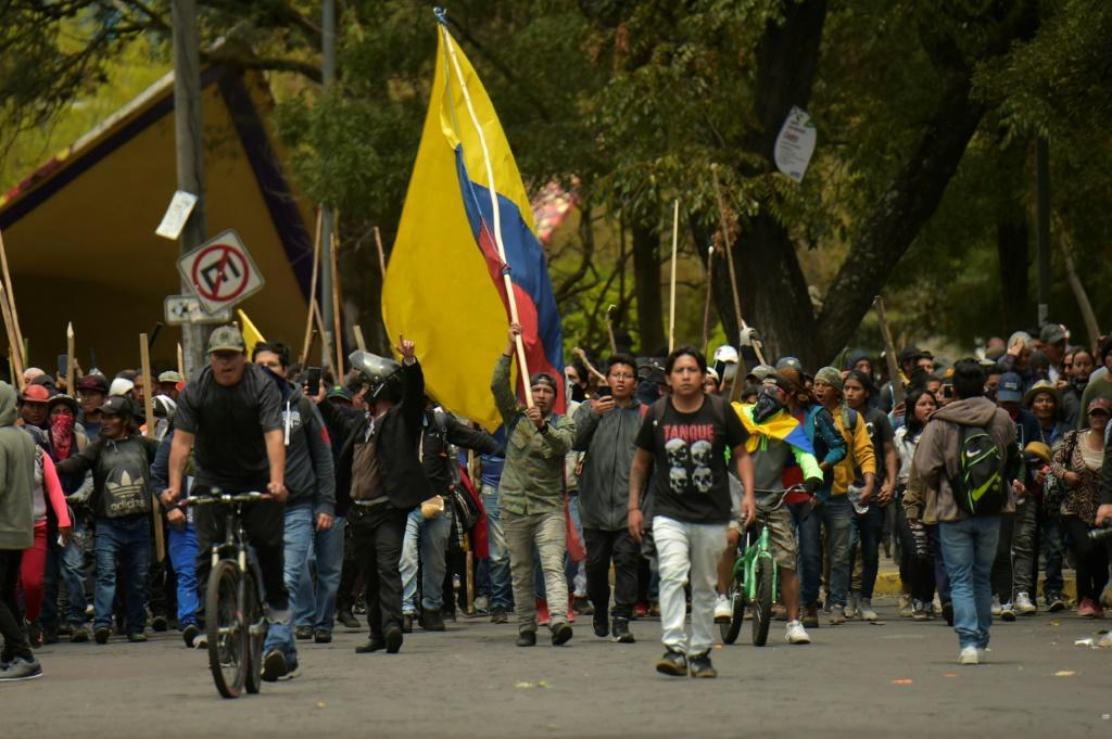Demonstrators march into Quito to bring their protest against a sharp rise in fuel prices to the capital