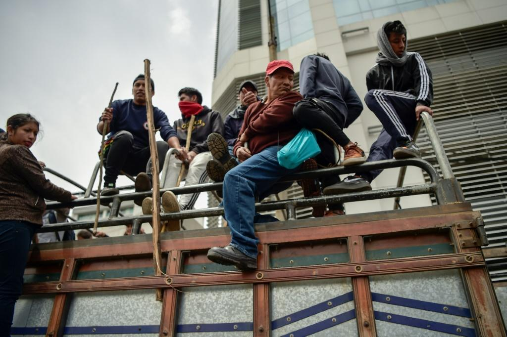Indigenous people and peasants arrive in Quito following days of protests against the sharp rise in fuel prices sparked by the government's decision to scrap subsidies