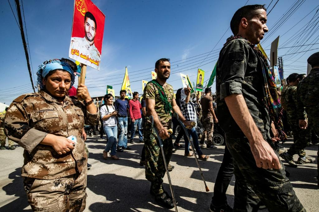 Kurdish fighters and veterans staged demonstrations against Turkey's planned offensive