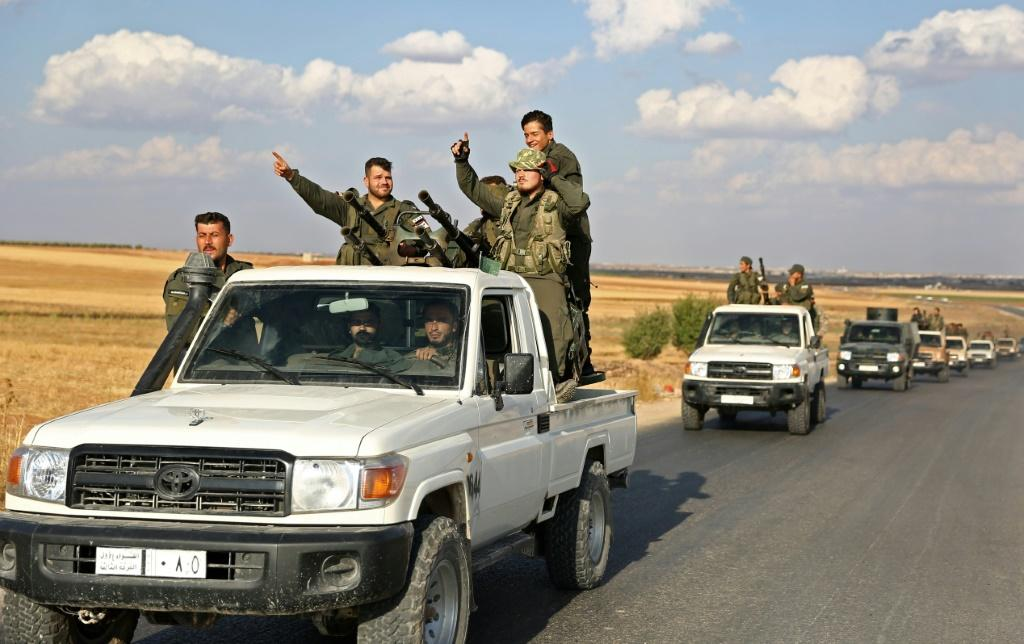 Turkish-backed Syrian rebel fighters are gathering near the border, with Ankara saying preparations have been completed for an offensive into northern Syria