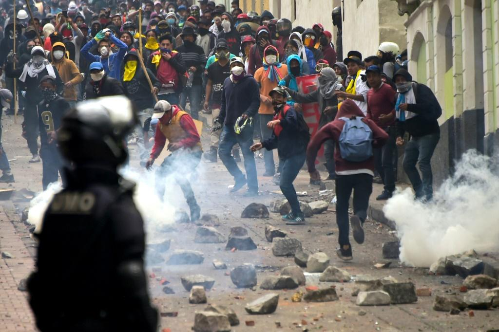 Demonstrators clash with riot police in Quito, as thousands march against Ecuadorean President Lenin Moreno's decision to slash fuel subsidies