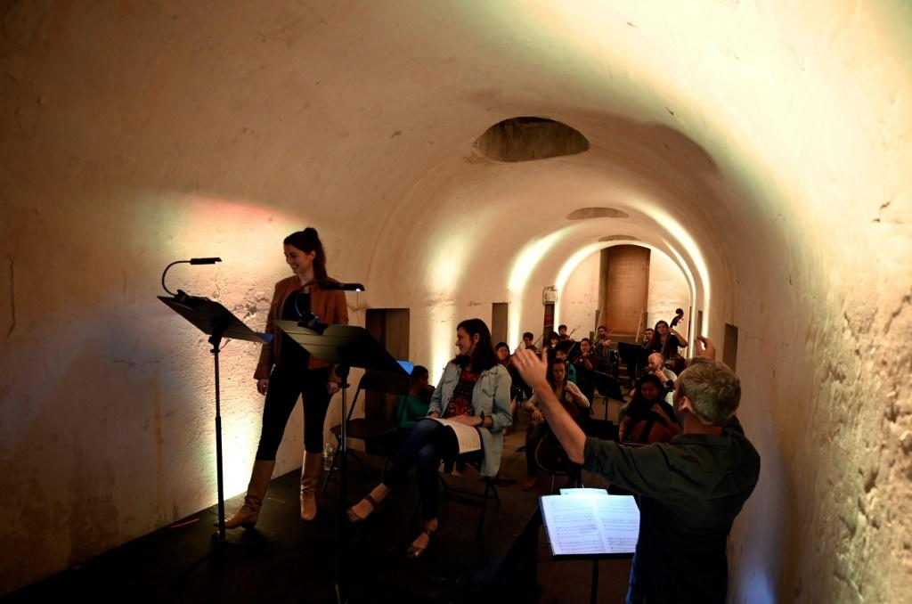 Eli Spindel conducts members of the String Orchestra of Brooklyn as they rehearse for a series held in the Green-Wood Cemetery catacombs, which are normally closed to the public