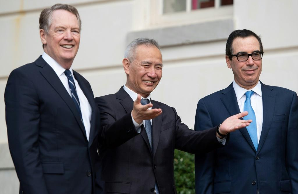 Chinese trade envoy Liu He is greeted Thursday by US Trade Representative Robert Lighthizer (L) and Treasury Secretary Steven Mnuchin (R)