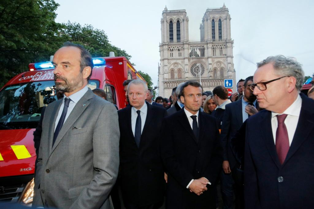 French Prime Minister Edouard Philippe (L) and French President Emmanuel Macron (3rd L) visited Notre-Dame