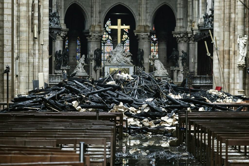 The altar surrounded by charred debris inside Notre-Dame after the fire