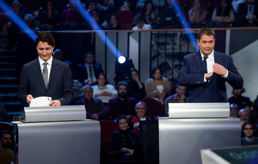 Canada's Prime Minister and Liberal leader Justin Trudeau (L) and Conservative leader Andrew Scheer take part in an election debate on October 10, 2019