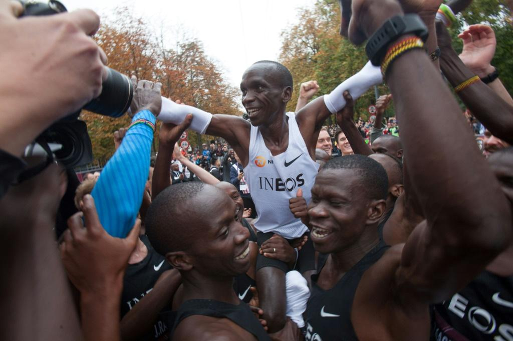 Kipchoge carried in triumph after his historic feat