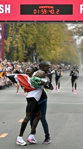 Kipchoge celebrates with his wife Grace
