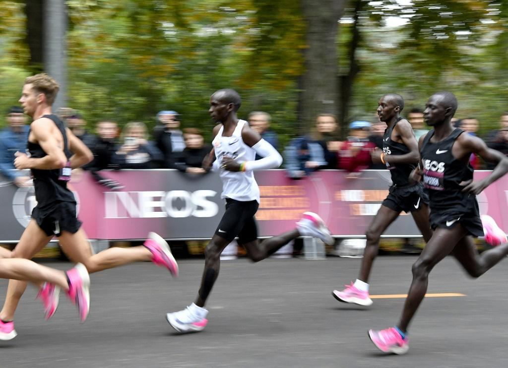 Kipchoge (white jersey) during his history-making run