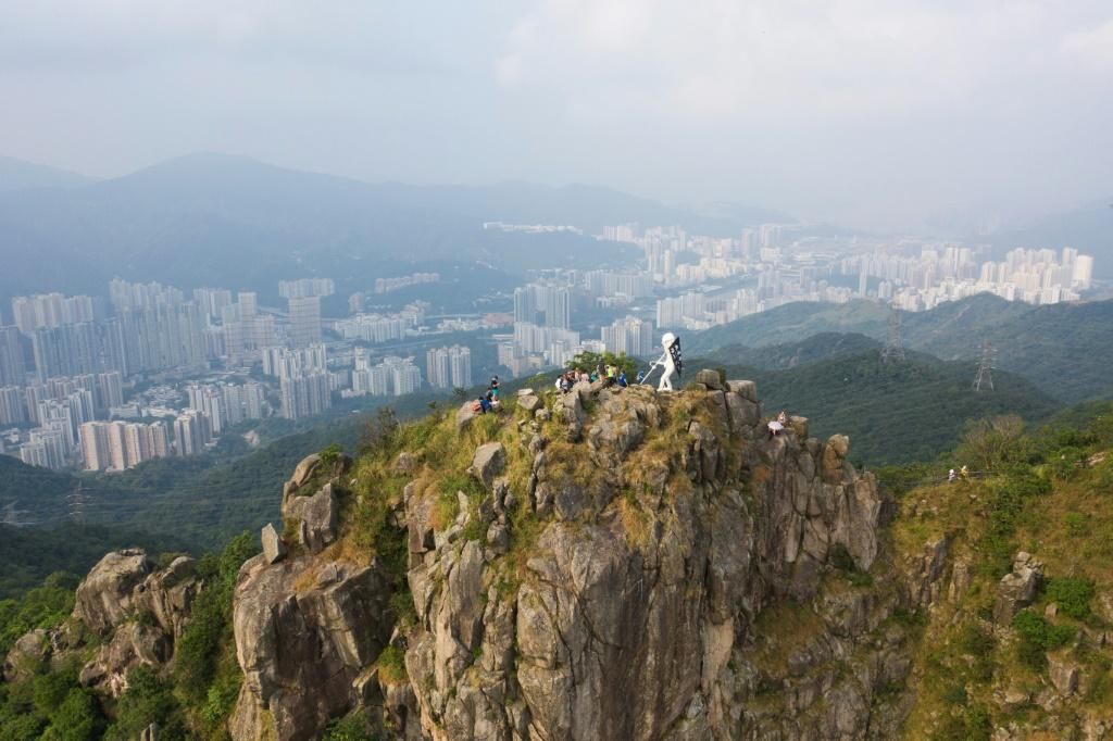 """A four-metre statue known as """"Lady Liberty"""" is placed by pro-democracy protesters on the top of Lion Rock, a Hong Kong landmark"""
