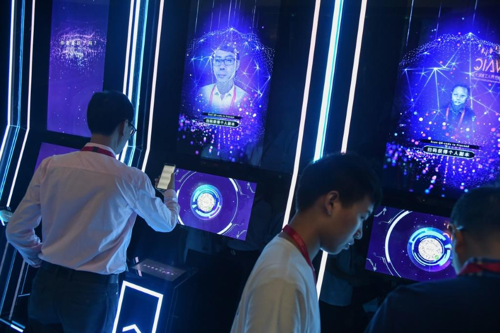 China's AI technology companies are rising stars -- here people have their faces scanned at the World Artificial Intelligence Conference in Shanghai