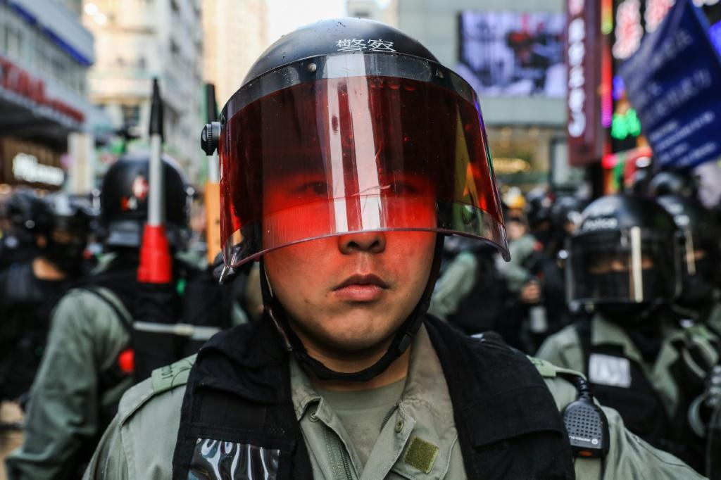 Throughout the day, Hong Kong police found themselves berated and heckled by bystanders as they made arrests
