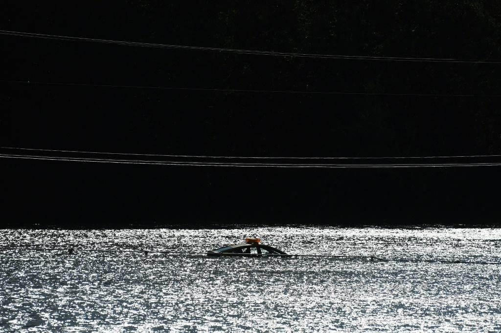 A car is barely visible, trapped by floodwaters in the aftermath of Typhoon Hagibis in Kakuda, Japan's Miyagi prefecture