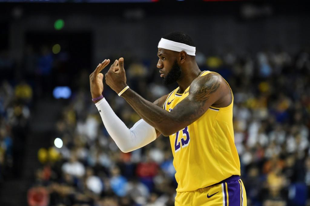 Los Angeles Lakers superstar LeBron James gestures while playing against the Brooklyn Nets on October 10, 2019 at the Mercedes-Benz Arena in Shanghai, China