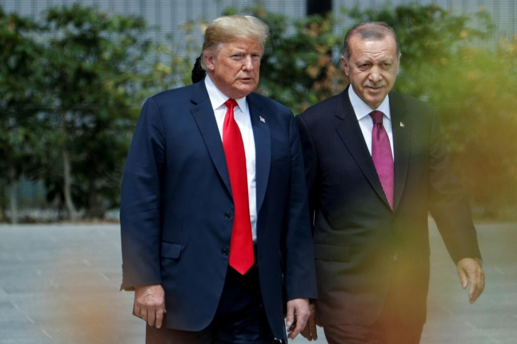 US President Donald Trump strolls with Turkish President Recep Tayyip Erdogan during a July 2018 visit at the NATO headquarters