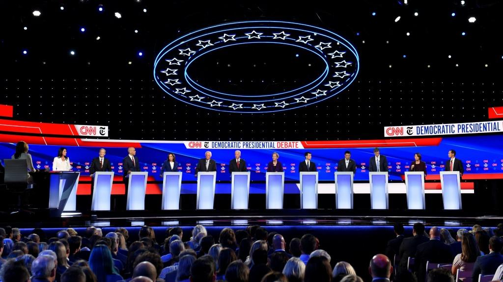 From the opening moments, most of the dozen Democrats on the debate stage in Ohio launched fierce broadsides against Donald Trump over the Ukrainian scandal at the heart of the impeachment inquiry