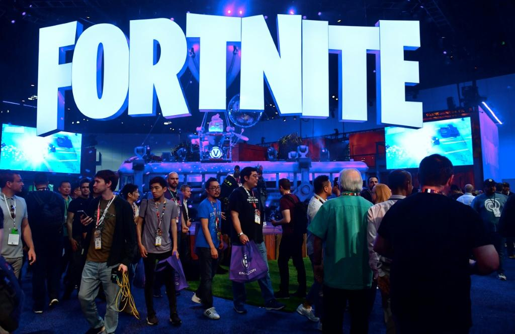 In this file photo taken on June 12, 2018, people crowd the display area for the survival game Fortnite at the 24th Electronic Expo, or E3 2018, in Los Angeles