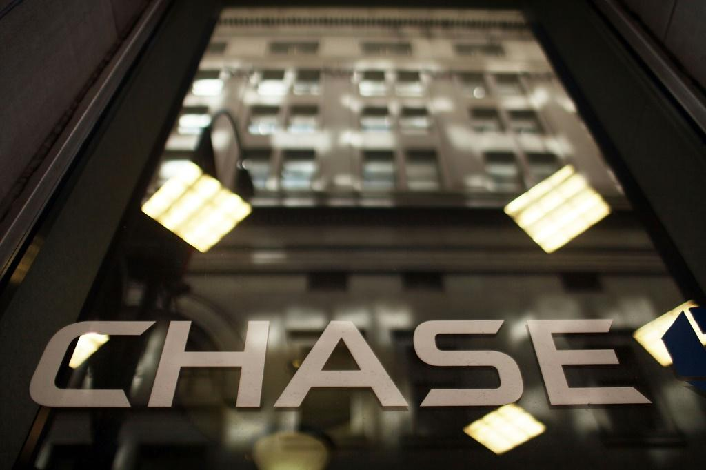 JPMorgan Chase reported higher third-quarter profits behind strength in key consumer banking businesses as Chief Executive Jamie Dimon offered a mixed economic outlook