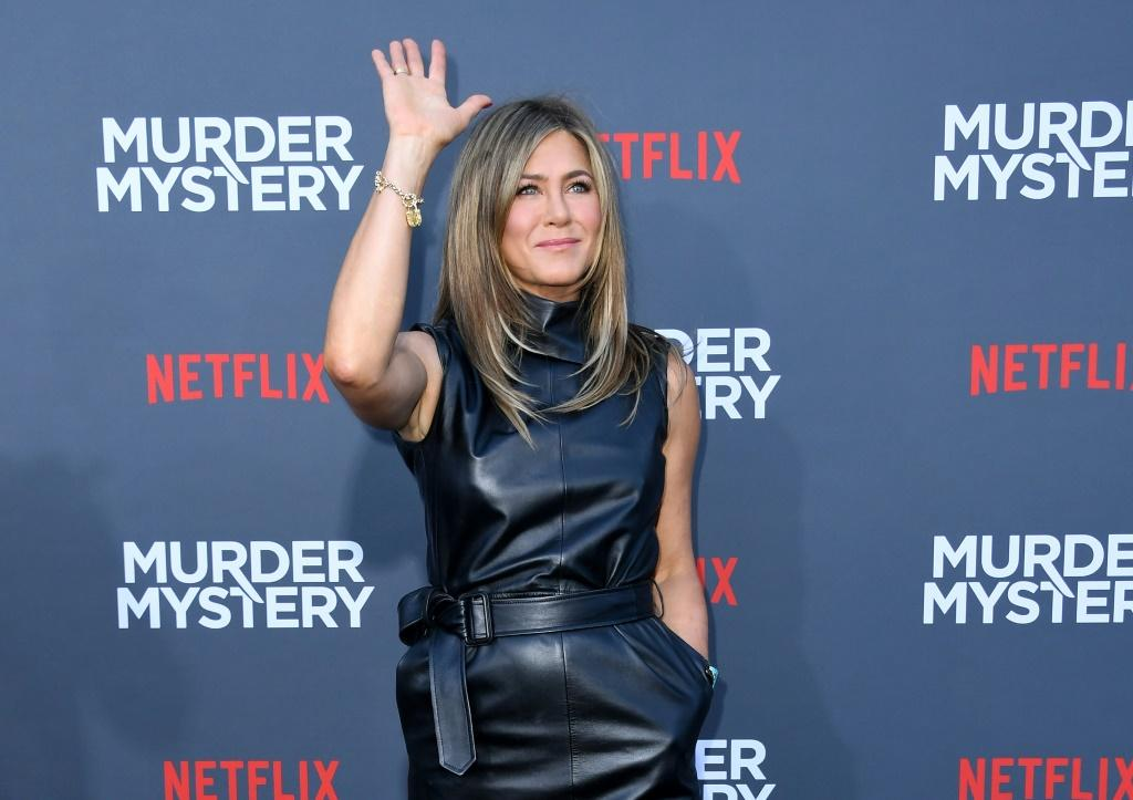 "Actress Jennifer Aniston arrives to attend the Los Angeles premiere screening of the Netflix film ""Murder Mystery"" at the Regency Village Theatre in Los Angeles on June 10, 2019"