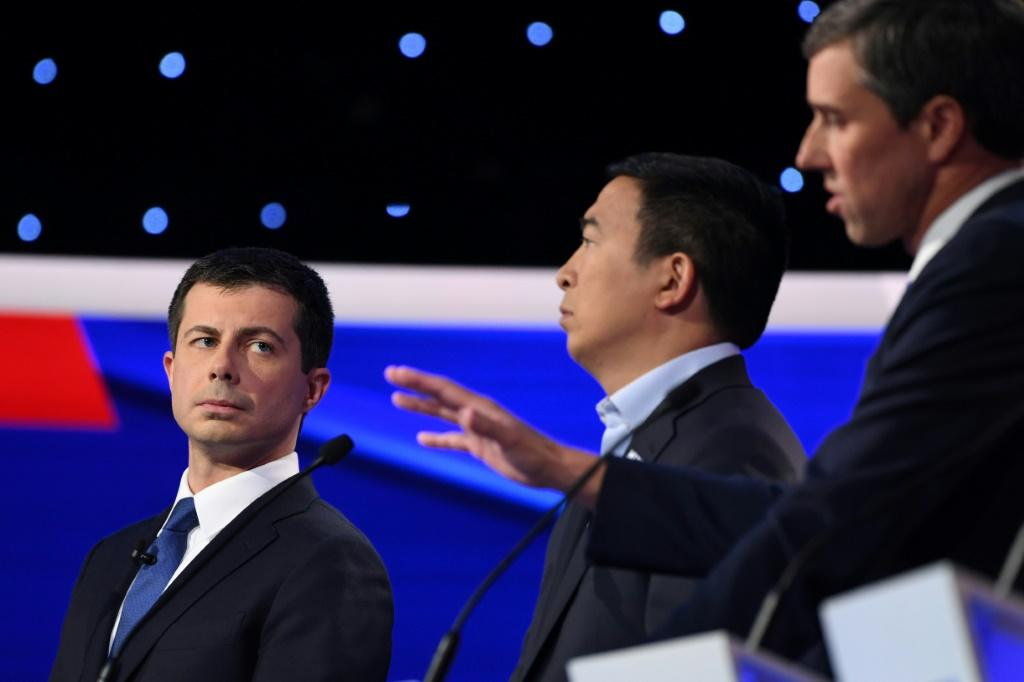 Democratic presidential hopeful Pete Buttigieg, the mayor of South Bend, Indiana (L) entrepreneur Andrew Yang (C) and ex-congressman Beto O'Rourke at the fourth Democratic primary debate of the 2020 presidential race