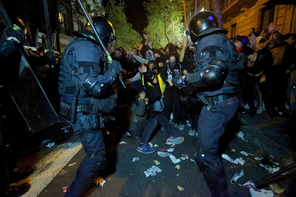 Protesters clashed with Catalan regional police during a protest in front of the Spanish Government delegations in Barcelona