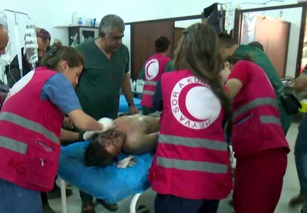The Syrian Observatory for Human Rights said nearly 500 people have been killed, mostly on the Kurdish side. Shown here are Syrian Kurdish doctors treating the wounded