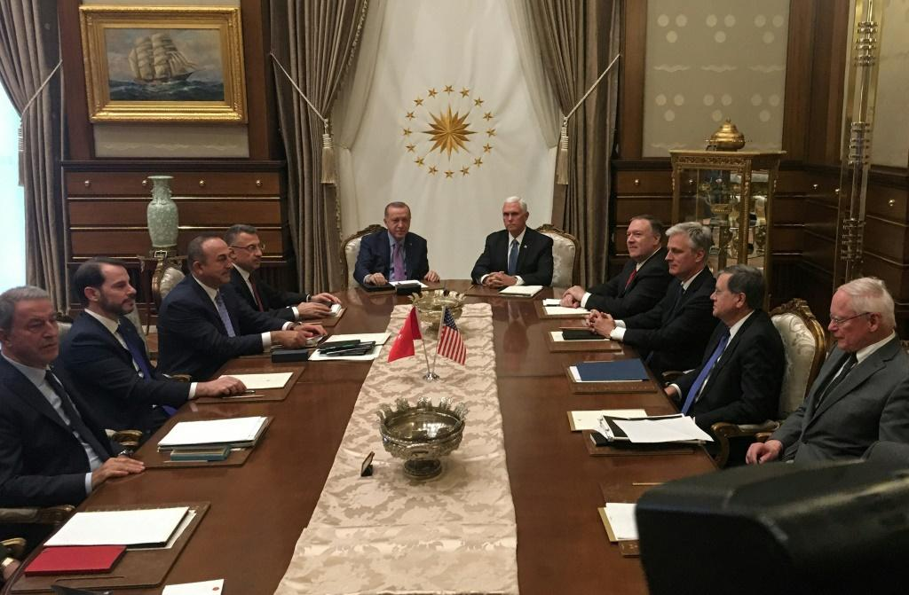 Turkish President Recep Tayyip Erdogan (C-L) and US Vice President Mike Pence (C-R), joined by Secretary of State Mike Pompeo (4R), Turkish Vice President Fuat Oktay (4L), Turkish Foreign Minister Mevlut Cavusoglu (3L) and senior aides, meet at the presid