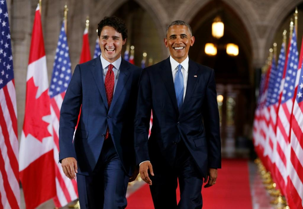 Former US president Barack Obama (R) has endorsed Canadian Prime Minister Justin Trudeau (L) for another term -- the pair are seen in Ottawa in June 2016