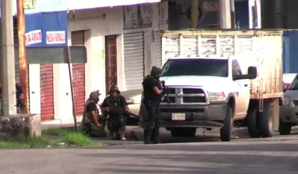 "Gunmen take position in Culiacan, Mexico, where security forces arrested one son of jailed drug kingpin Joaquin ""El Chapo"" Guzman"