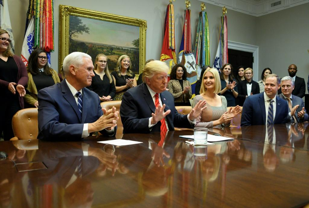 US President Donald Trump (C), Vice President Mike Pence (L), Advisor to the President Ivanka Trump (3rd R) and NASA Administrator Jim Bridenstine (2nd R) speak to NASA astronauts Christina Koch and Jessica Meir during the first all-woman spacewalk
