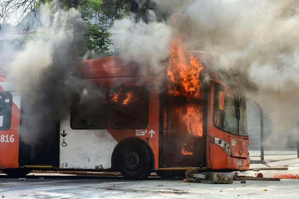 A bus burns during clashes between protesters and riot police in Santiago, Chile October 19, 2019