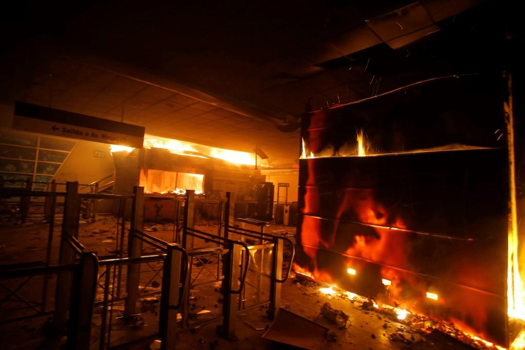 Dozens of Santiago metro stations were torched, forcing the closure of the entire subway network