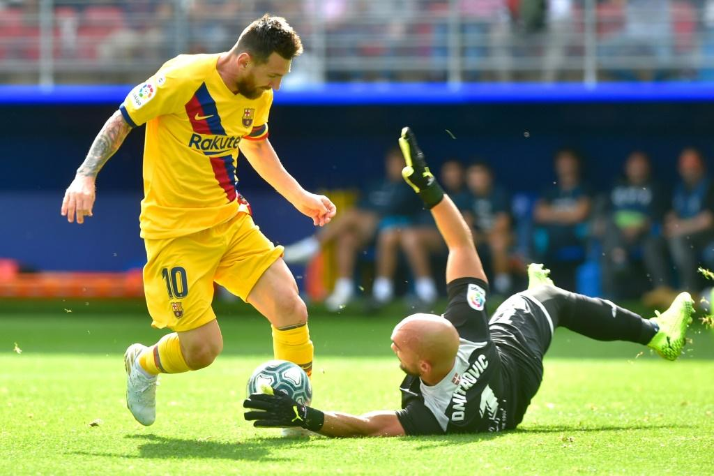 Eibar goalkeeper Marko Dmitrovic stopped Lionel Messi once, but the Barcelona striker then scored his second goal of the season