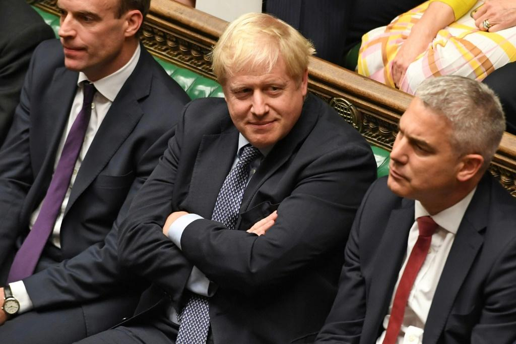 A defiant Boris Johnson (C) had earlier told MPs he would not negotiate a Brexit delay with the EU