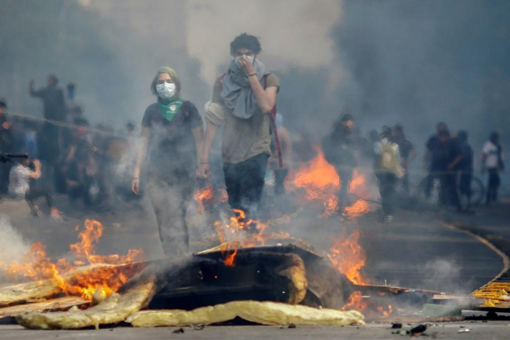 Two days of violent unrest in Santiago have seen metros and buses burned, and clashes between riot police and protesters