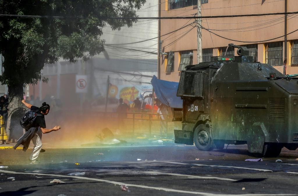 Clashes in Chile have seen police and military fire tear gas and water cannon against protesters