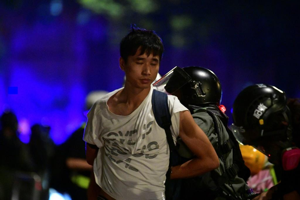 Riot police detain another pro-democracy demonstrator in Hong Kong on Monday