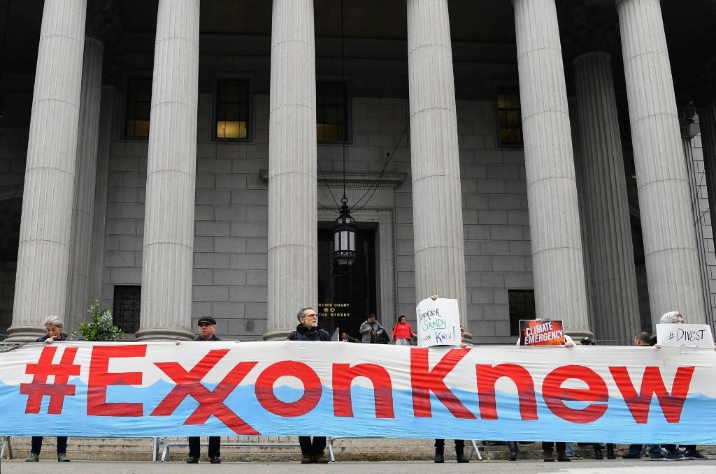 Climate activists protest on the first day of the ExxonMobil trial outside the New York State Supreme Court building