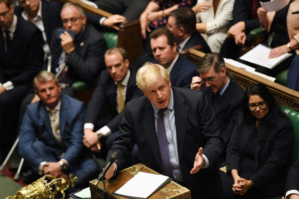 "Prime Minister Boris Johnson (C) reiterated his desire to stick to the October 31 date and said Britain would step up preparations in case of a disorderly ""no deal"" exit"