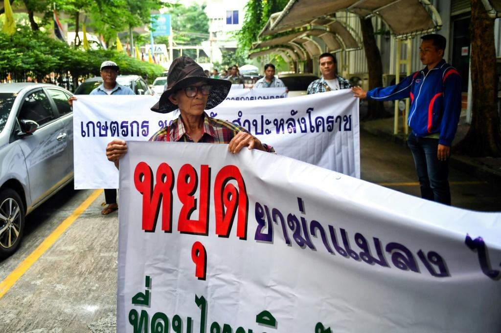 Representatives of Thai farmers arrive at the Ministry of Industry in Bangkok to support certain pesticides, but the National Hazardous Substances Committee voted to ban glyphosate and the chemicals paraquat and chlorpyrifos, officials said
