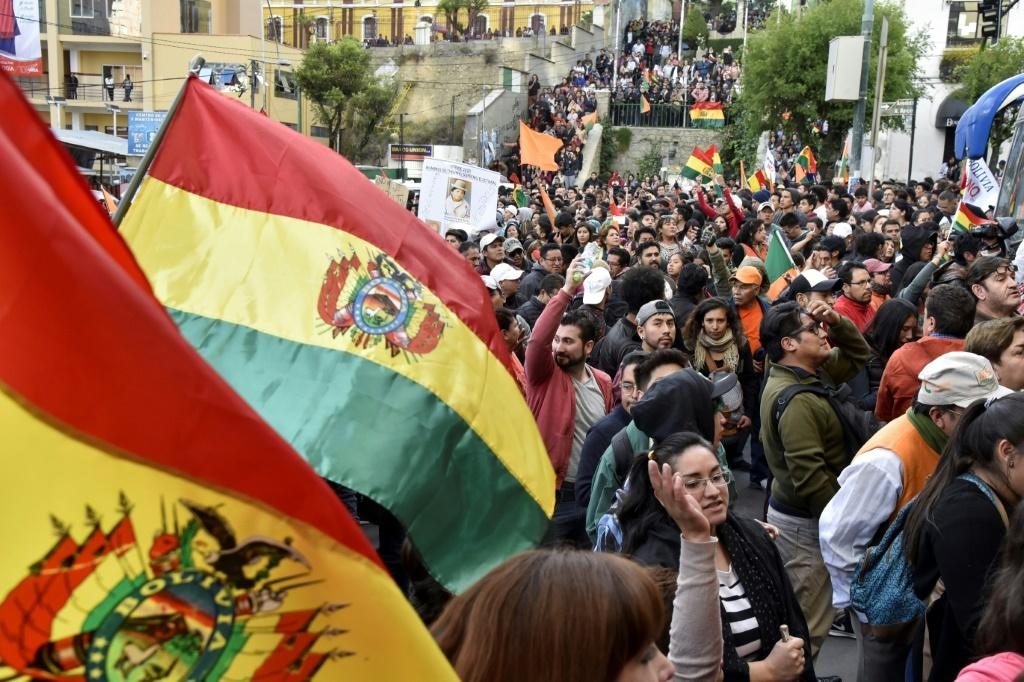 Revised results in Bolivia's presidential election, released after a long and unexplained delay, showed Morales edging towards an outright victory with 95 percent of the votes counted