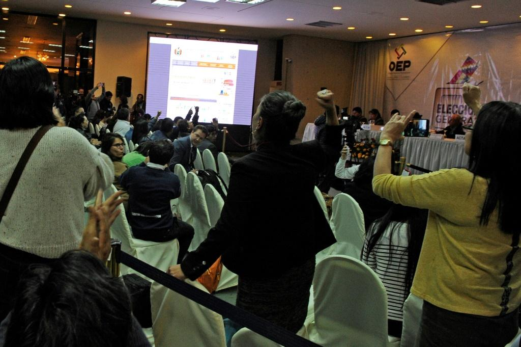 Rival election delegates in Bolivia shout slogans at each other in vote count headquarters