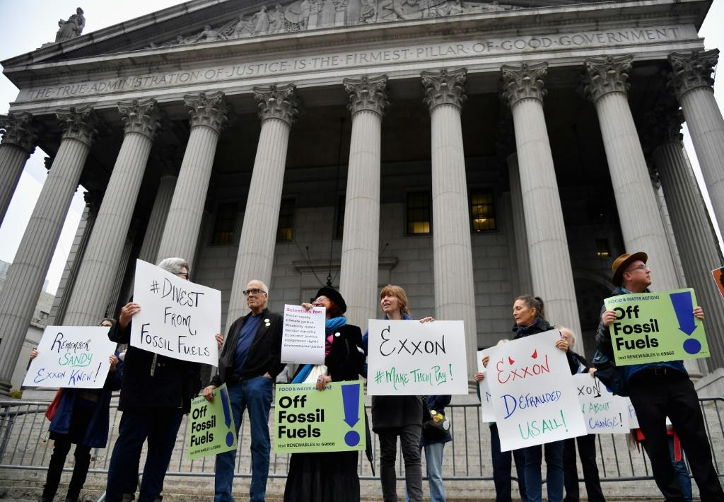 Some environmental activists attended a Manhattan hearing in the unprecedented trial against Exxon after protesting outside of court
