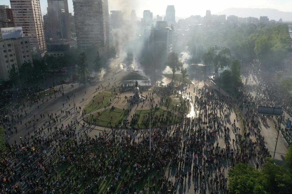 Violent unrest in Santiago has seen metros and buses burned, and clashes between riot police and protesters