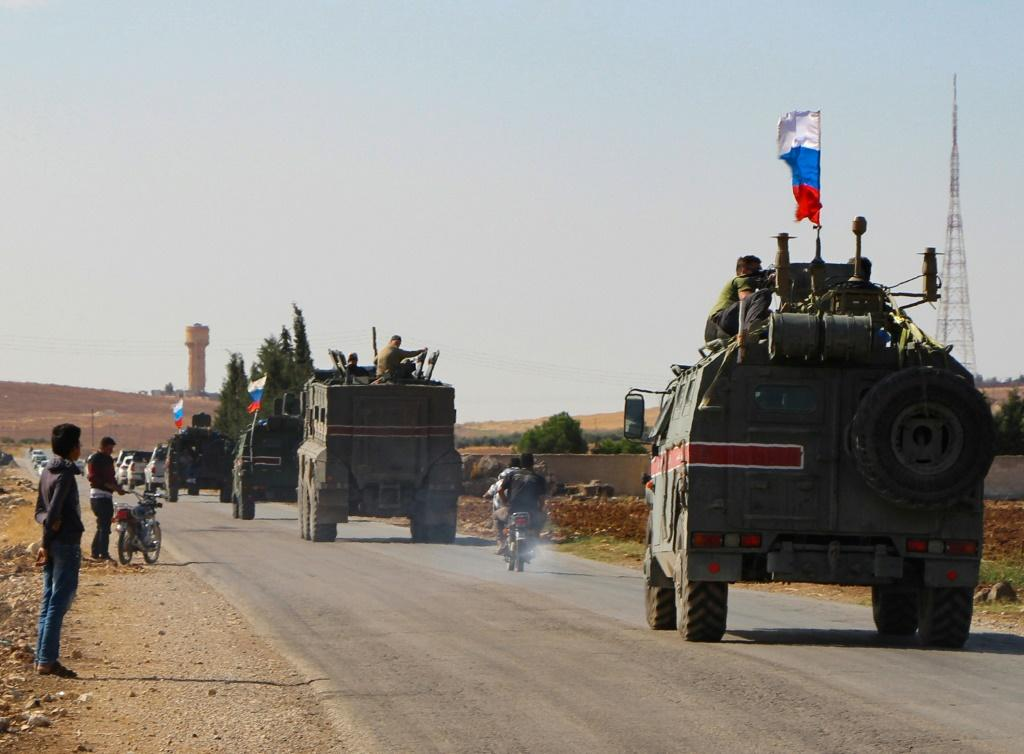 A convoy of Russian military vehicles heads towards the northeastern Syrian city of Kobane