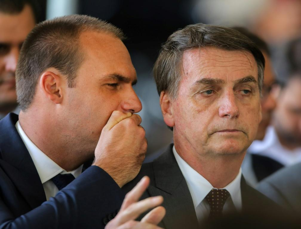 Eduardo Bolsonaro (L) presents a more polished image than his father the president, who often appears ill at ease in public